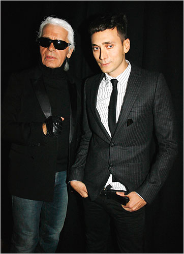 Karl Lagerfeld with thin male fashion model.